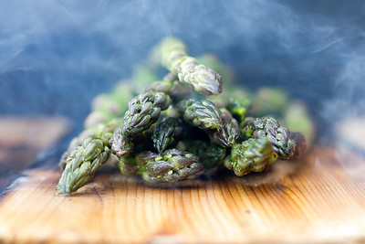 """Smoking Asparagus""  A cedar plank on a grill with asparagus.  © 2011 - Nicole S. Young"