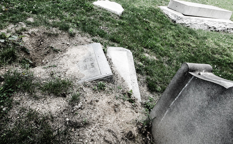 Another headstone almost completely swallowed by the land.