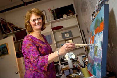 "One of Lois Andersen's earliest memories is ""making things."" Her father was an artist, and Andersen's early childhood was a nurturing environment that provided the freedom of unstructured time with the provision of simple art materials. ""I had lots of time to wonder about things, and try to make them,"" says Andersen. As she grew, Andersen's art-making focus turned to 2-D before she eventually became a painting student at Pratt Institute and the Art Student's League in NY.    ""Painting is an on-going inquiry,"" says Andersen, and that process can ""never fully be realized,"" because there is always more to reach for. ""It's deadly to focus on the idea of a perfect product; there is no such thing and you will be robbed of the joy that comes with the pursuit.""   Andersen describes her painting as Expressionist/Realist; she teaches at the EU, and does some illustration. She taught art for more than twenty-five years, before making the decision to focus on her painting. As a resident artist at Emerson Umbrella, Andersen says, ""It's the perfect place for me where I am able to pursue my painting and also have opportunity to teach.""   As a teacher, Andersen welcomes students from many levels of experience. She explains, ""My job is to help people get a little further, in each effort, to move forward. To learn what their strength is and help them pursue it. It's fun to teach someone who is completely new to art because they are so open, and usually surprised at how good their first efforts are."" Andersen believes that training in the basics of the elements of design, handling of mediums and lots of practice is key and that structure is the route to freedom of expression later on.     Andersen explains a growing desire to move forward—take on new direction—in her painting. She grew tired of her ""little paintings and landscapes; I knew something was going to change but I didn't know what it was going to look like."" Andersen's family heritage is Norwegian, and she spent time in Norway as a student. She has been to her father's homeland many times with a recent trip to the Norwegian Arctic this past summer. ""As I became absorbed into that austere landscape, it resonated so deeply. These images have become the focus of new work; much larger paintings, deep and moody, huge, ponderous landscapes.""   Anderson references her most recent painting, a large abstract with sweeping brushstrokes and fun, bold colors. ""I love that feeling of feeling like I'm nothing in a huge space…it touches on the eternal…it's so big and so far beyond you."""