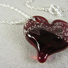 Red heart pendant with sterling silver necklace.