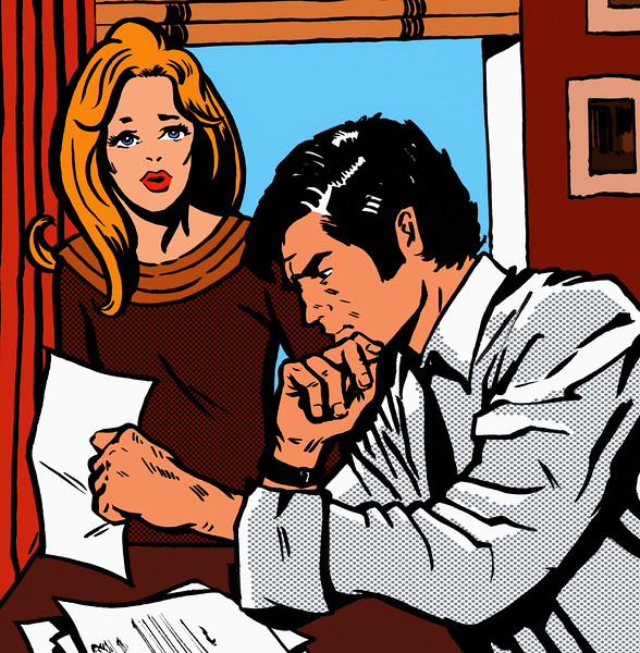 Worried couple looking at bills --- Image by © Jacquie Boyd/Ikon Images/Corbis