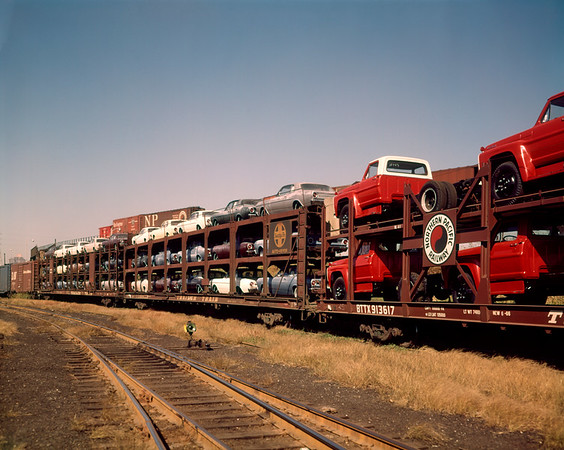 01 Jan 1965 --- 1960 1960s new cars & trucks transported on northern pacific railroad railway train transportation --- Image by © D. Corson/ClassicStock/Corbis