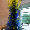 """PALM COURT TOWER"" (2007) by Dale Chihuly<br /> Dimensions: 190 X 82 X 87""<br /> <br /> ""The idea of a Tower just came from looking at one of my Chandeliers and imagining what it would look like upside down."" ~ Dale Chihuly<br /> <br /> 2nd Level - Sky Lobby<br /> ""CHIHULY"" 2014 Exhibit<br /> William J. Clinton Presidential Library and Museum<br /> little Rock, AR"