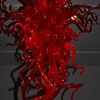 "A ""RED CHANDELIER"" by Dale Chihuly<br /> <br />  A glass art piece by Dale Chihuly that is included in ""The GALLERY featuring DALE CHIHULY"" Exhibit<br /> <br />  Dale Chihuly made his first Chandelier in 1992 for the Seattle Art Museum. <br /> <br />  ""I'd seen a chandelier in a restaurant in Barcelona when I was traveling. The chandelier was hanging at eye level. It was really beautiful. When you sat down to eat you looked underneath it, and it acted as a centerpiece for the table. I loved this idea of hanging a chandelier at eye level. And it triggered something that said, I now can make a chandelier, because it doesn't have to be functional."" ~ Chihuly (Reprnted text from here: <a href=""http://www.chihuly.com/chandeliers-artists-statement.aspx"">http://www.chihuly.com/chandeliers-artists-statement.aspx</a>)<br /> <br /> The Gallery at City Center (Gallery Row)<br />  Inside Crystals at City Center <br />  3720 S. Las Vegas Blvd. <br />  Las Vegas, NV 89109"