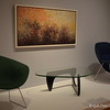 """""""TORCH"""" (1960) by Norman Wilfred Lewis<br /> Oil on Canvas<br /> <br /> """"DIAMOND ARMCHAIR"""" (designed 1950 - 1952, 1965) by Harry Betoia<br /> Made from vinyl-coated steel and wood upholstery<br /> <br /> """"COFFEE TABLE"""" (1948-1953), designed 1946 by Isamu Noguchi<br /> Made from Ebonized birch, glass, and aluminum<br /> <br /> """"WOMB ARMCHAIR"""" (1947-1948) by Eero Saarinen<br /> Made from chromed steel, molded fiberglass, and wood upholstery<br /> <br /> High Museum of Art<br /> 1280 Peachtree Street, N.E. <br /> Atlanta, GA 30309<br /> Official website: <a href=""""http://www.high.org"""">http://www.high.org</a><br /> <br /> (photo taken 7/25/2014)<br /> <br /> My Homepage:  <a href=""""http://www.godschild.smugmug.com"""">http://www.godschild.smugmug.com</a>"""