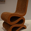 """""""EASY EDGES"""" by Frank O. Gehry<br /> <br /> """"The architect Frank O. Gehry worked with corrugated cardboard in thick, laminated layers, as if it were a solid, durable substance. The ease of die-cutting the corrugated cardboard allowed him to create both regular and eccentric shapes—such as this ribbon-like form—that were included among the seventeen pieces of Easy Edges furniture he put into production in 1972. Gehry used the exposed edges rather than the flat planes as his surface, based on the layered construction of architects' contour models. Having conducted thorough research on the material, he understood its properties. He soon patented the method of construction and developed an efficient manufacturing system, with the end result of inexpensive, well-made goods.""""<br /> <br /> Artist Name:  Frank O. Gehry<br /> Nationality & Life Dates:  American, born 1929<br /> Title:  Easy Edges<br /> Date:  ca.1970<br /> Medium:  Corrugated cardboard, fiberboard<br /> Dimensions:  34 x 15 x 25 inches<br /> Credit Line:  Purchase with funds from the Decorative Arts Acquisition Trust<br /> Accession Number:  1996.129<br /> On View - Stent Family Wing, Skyway Level, Gallery 404 <br /> <br /> ~ Reprinted information from here: <a href=""""http://www.high.org/Art/Permanent-Collection/CollectionDetails.aspx?deptName=Decorative"""">http://www.high.org/Art/Permanent-Collection/CollectionDetails.aspx?deptName=Decorative</a> Arts and Design&objNum=1996.129&pageNumber=4&search=true#.U9Zl2enwuUk<br /> <br /> High Museum of Art<br /> 1280 Peachtree Street, N.E. <br /> Atlanta, GA 30309<br /> Official website: <a href=""""http://www.high.org"""">http://www.high.org</a><br /> <br /> (photo taken 7/25/2014)<br /> <br /> My Homepage:  <a href=""""http://www.godschild.smugmug.com"""">http://www.godschild.smugmug.com</a>"""