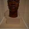 """""""TARGET""""  by Elizabeth Catlett<br /> <br /> """"Sculptor and graphic artist Elizabeth Catlett is perhaps best known for her work's emphasis on themes of racial injustice, social and political protest, love, dignity, and essential human vitality. With Target Catlett summarizes the African American male experience in a society fraught with social conflict. This piece predates the better-known bronze of the same title and subject, which also includes an enlarged gun sight that literally centers the man's face in the crosshairs of the viewer.""""<br /> <br /> Artist Name:  Elizabeth Catlett<br /> Nationality & Life Dates:  American, 1915 - 2012<br /> Title:  Target<br /> Date:  ca. 1955<br /> Medium:  Terracotta<br /> Dimensions:  14 x 10 x 8 inches<br /> Credit Line:  Purchase with funds from Bridget and Jerry Dobson and General Acquisitions Fund<br /> Accession Number:  2006.28<br /> Copyright: © Elizabeth Catlett/Licensed by VAGA, New York, NY<br /> On View - Stent Family Wing, Skyway Level, Gallery 404 <br /> <br /> ~ Reprinted information from here:  <a href=""""http://www.high.org/Art/Permanent-Collection/CollectionDetails.aspx?deptName=Modern"""">http://www.high.org/Art/Permanent-Collection/CollectionDetails.aspx?deptName=Modern</a> and Contemporary Art&objNum=2006.28&pageNumber=3&search=true<br /> <br /> High Museum of Art<br /> 1280 Peachtree Street, N.E. <br /> Atlanta, GA 30309<br /> Official website: <a href=""""http://www.high.org"""">http://www.high.org</a><br /> <br /> (photo taken 7/25/2014)<br /> <br /> My Homepage:  <a href=""""http://www.godschild.smugmug.com"""">http://www.godschild.smugmug.com</a>"""