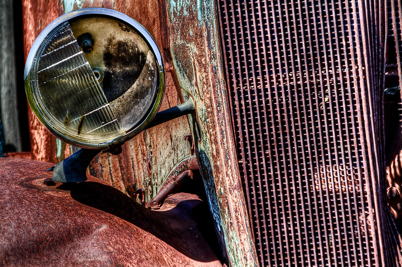 """Busted Headlight.<br /> Shaniko, Oregon<br /> By Brett Downen<br /> <br /> Float Mounted MetalPrint<br /> Available sizes: 4"""" x 6"""", 8"""" x 12"""", 16"""" x 24"""". 24"""" x 36"""""""