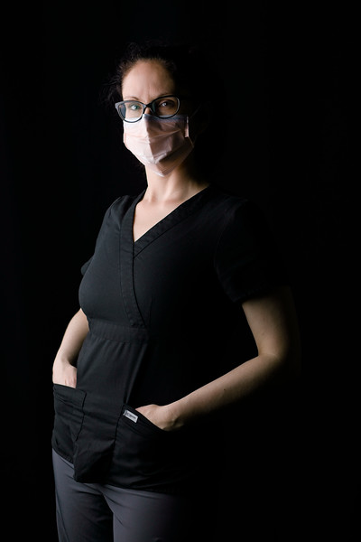 healthcare-worker-n95-threequarter-mask-black-scrubs
