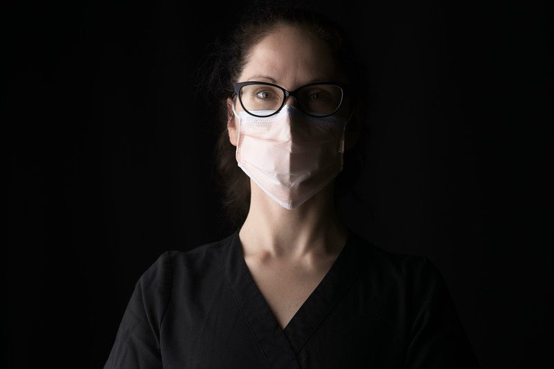 healthcare-worker-n95-mask-black-bg