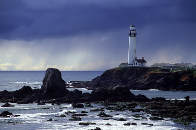 """Pigeon Point Lighthouse and an oncoming deluge.  Pescadero, California Digitized image originally captured on Fujichrome Velvia. By Brett Downen  Float Mounted MetalPrint Available sizes: 4"""" x 6"""", 8"""" x 12"""", 16"""" x 24"""". 24"""" x 36"""""""
