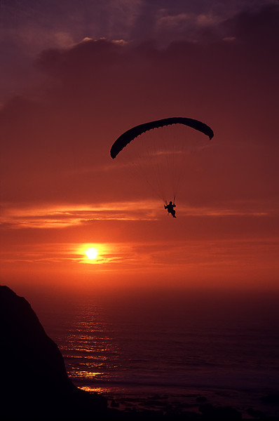 """Parasail over Ross' Cove<br /> Princeton by the Sea, California<br /> By Brett Downen<br /> <br /> Float Mounted MetalPrint<br /> Available sizes: 4"""" x 6"""", 8"""" x 12"""", 16"""" x 24"""". 24"""" x 36"""""""