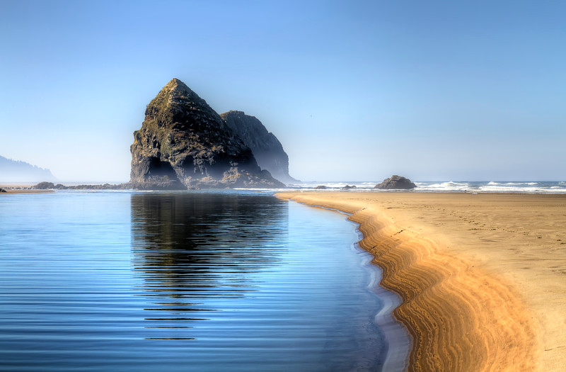 """Precision balancing my image at Cannon Beach, Oregon. Also had a wonderful discussion on Facebook about this image as the sharpness of an image like this can only really be achieved with a prime lens. This happened to be my 50mm 1.4 lens, which rarely comes off the camera these days!<br /> <br /> By Brett Downen<br /> <br /> Float Mounted MetalPrint<br /> Available sizes: 4"""" x 6"""", 8"""" x 12"""", 16"""" x 24"""". 24"""" x 36"""""""