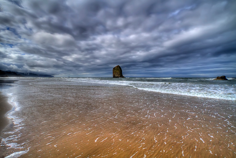 """The Fingertip Monolith<br /> Cannon Beach, Oregon<br /> By Brett Downen<br /> <br /> Float Mounted MetalPrint<br /> Available sizes: 4"""" x 6"""", 8"""" x 12"""", 16"""" x 24"""". 24"""" x 36"""""""