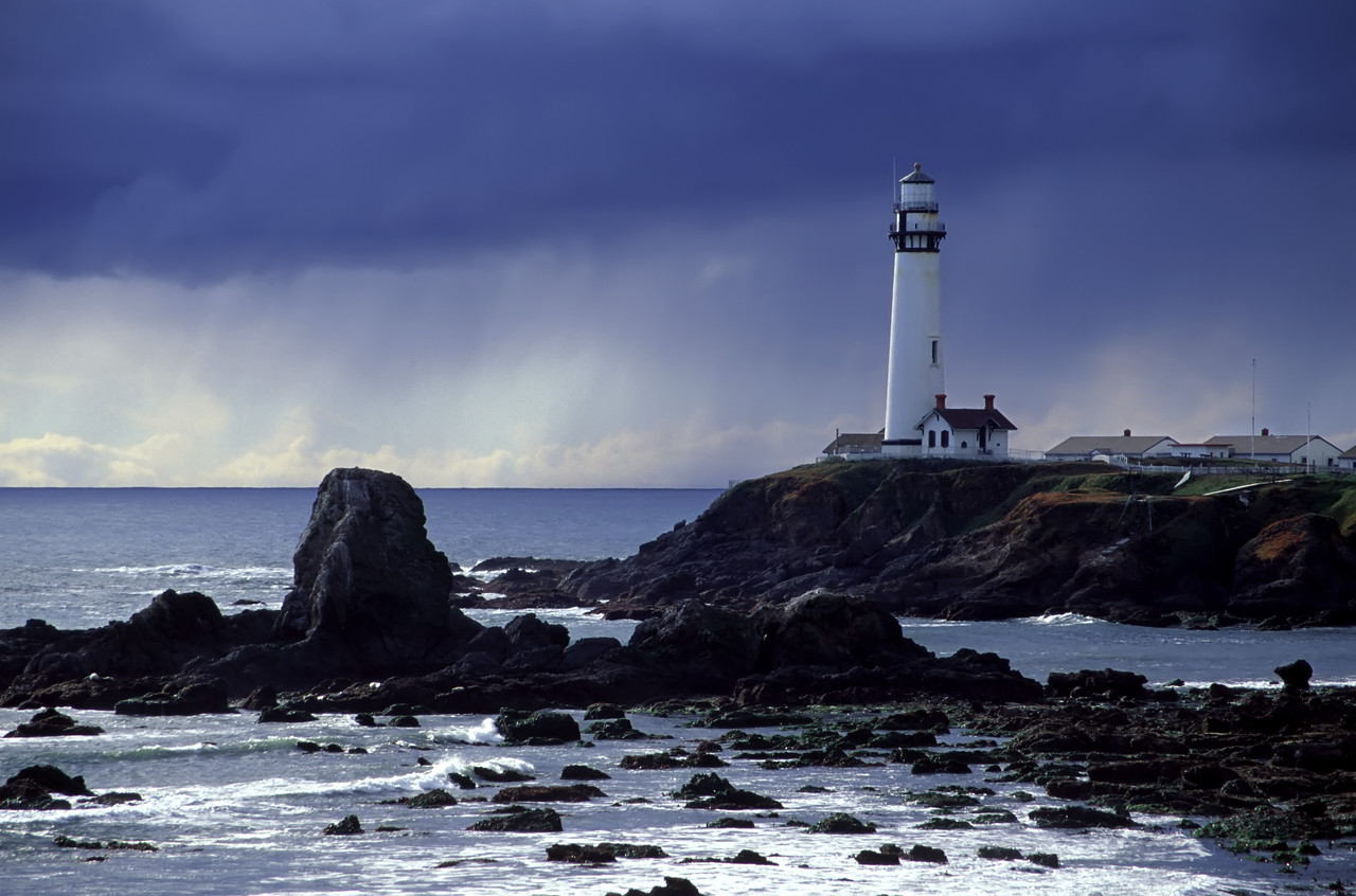 """Pigeon Point Lighthouse and an oncoming deluge. <br /> Pescadero, California<br /> Digitized image originally captured on Fujichrome Velvia.<br /> By Brett Downen<br /> <br /> Float Mounted MetalPrint<br /> Available sizes: 4"""" x 6"""", 8"""" x 12"""", 16"""" x 24"""". 24"""" x 36"""""""