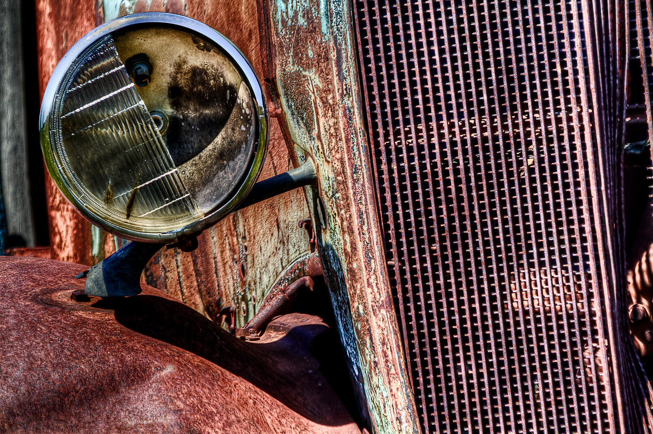 "Busted Headlight.<br /> Shaniko, Oregon<br /> By Brett Downen<br /> <br /> Float Mounted MetalPrint<br /> Available sizes: 4"" x 6"", 8"" x 12"", 16"" x 24"". 24"" x 36"""