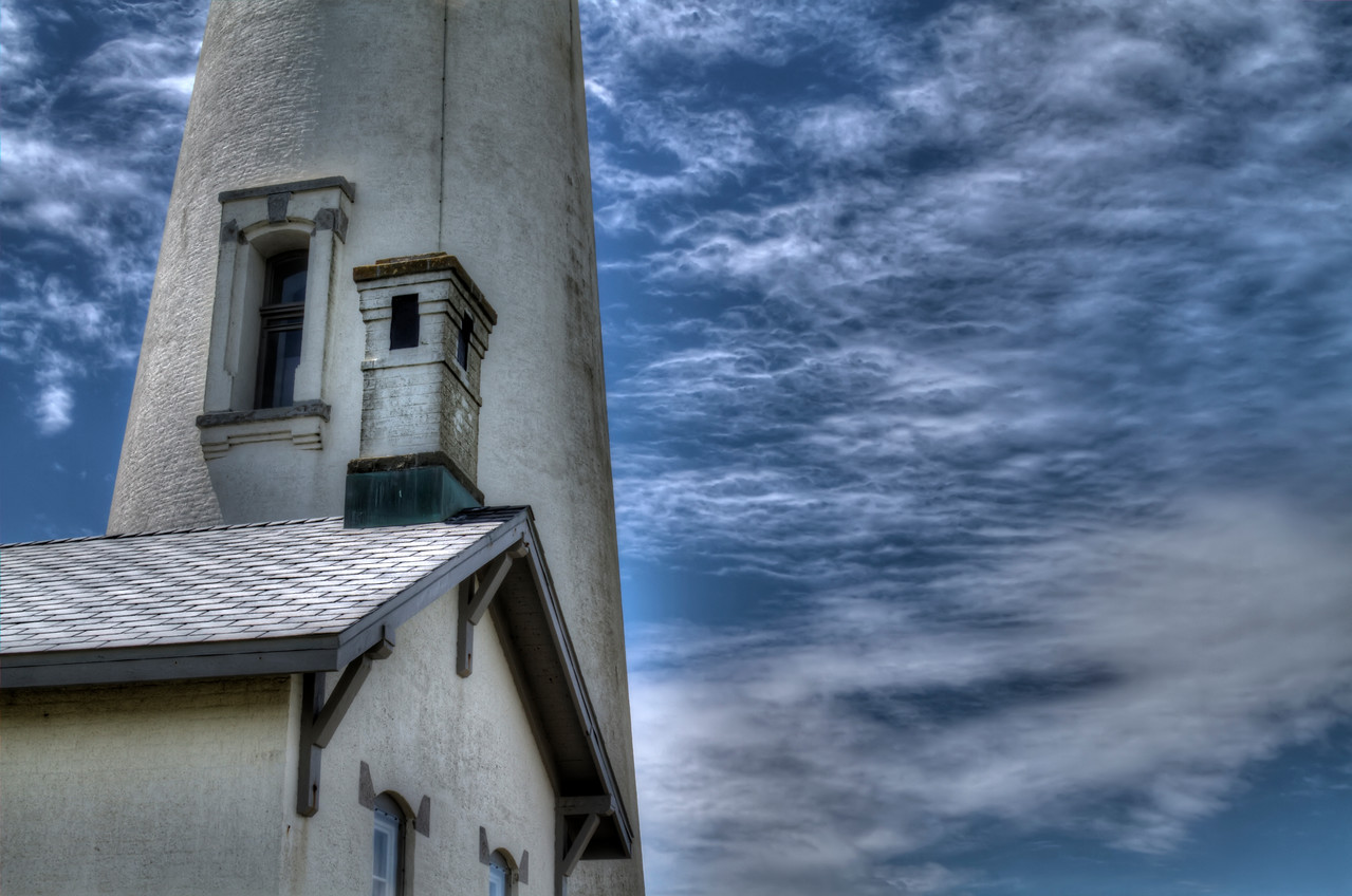 "Yaquina Bay Lighthouse standing watch on a blustery day.<br /> By Brett Downen<br /> <br /> Float Mounted MetalPrint<br /> Available sizes: 4"" x 6"", 8"" x 12"", 16"" x 24"". 24"" x 36"""