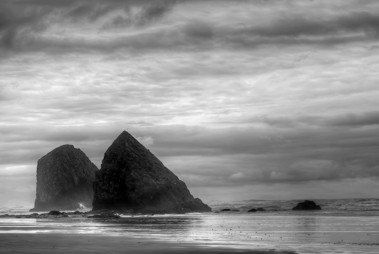 """The Other Monoliths of Cannon Beach, Oregon. They're not Haystack Rock but they're intimidating all the same.<br /> <br /> By Brett Downen<br /> <br /> Float Mounted MetalPrint<br /> Available sizes: 4"""" x 6"""", 8"""" x 12"""", 16"""" x 24"""". 24"""" x 36"""""""