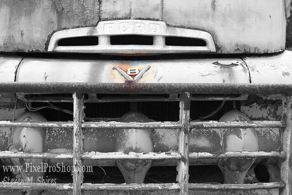 B&W with color highlight.  An old rusted truck grill.