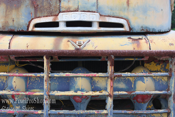 An old rusted truck grill.