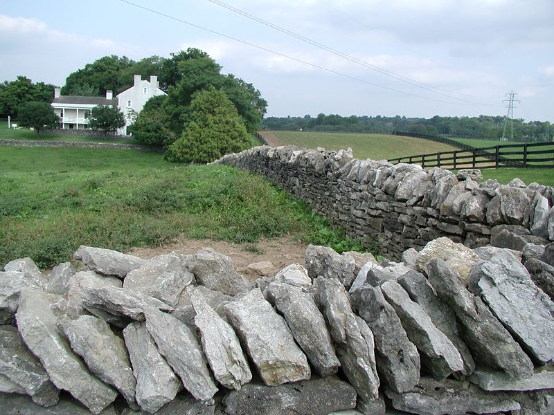 Rock fence and historic farm house, Shaker Village
