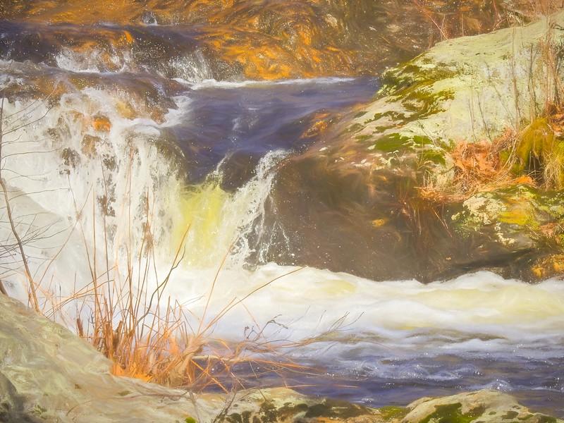 Water rushing around large boulders.