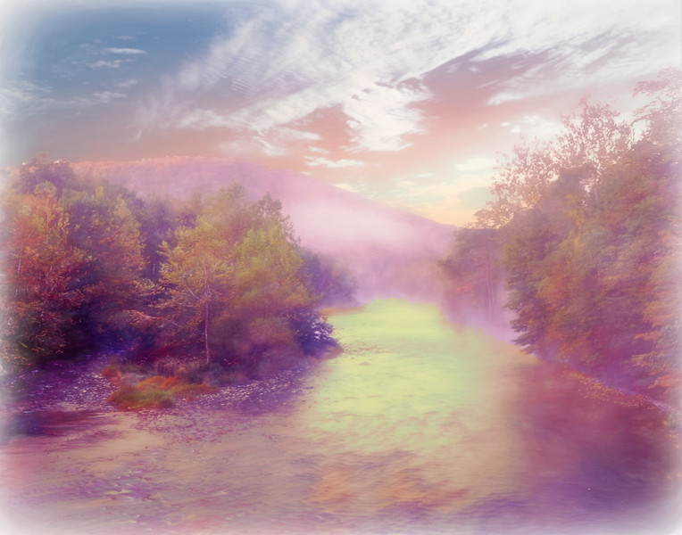 Early morning mist off a river running through autumn forest.