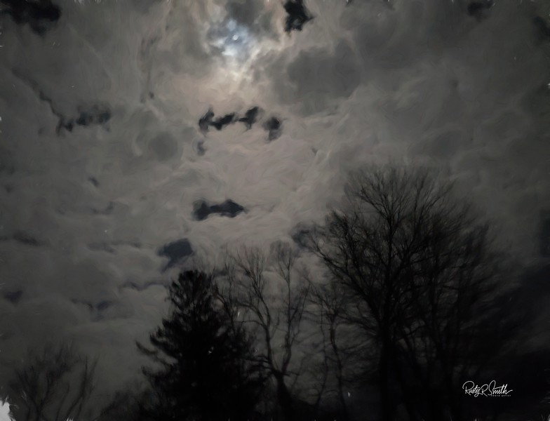 Night clouds and moon peeking through.