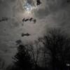 Night clouds and moon peeking through.
