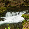 A small waterfall on Wykoff run Pennsylvania. Milky effect applied to show water movement. Artistic view of a waterfall.