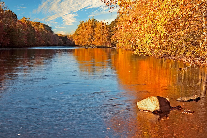 A horizontal Stock Photograph of the Shetucket RiverScotland Ct. on a beautiful Fall afternoon.