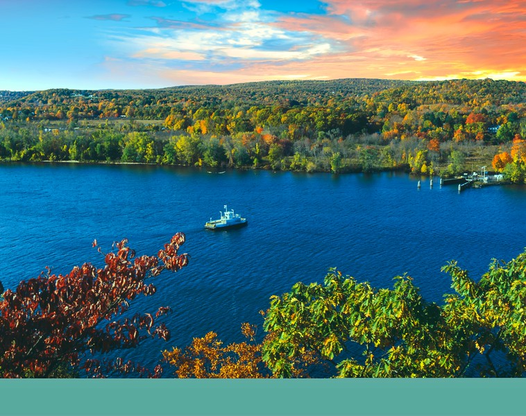 A horizontal Stock Photograph of the Hadlyme ferry crossing the Connecticut River. View from Gillette Castle State Park.