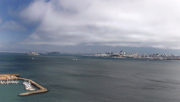 A horizontal stock photograph looking across San Francisco Bay, San Fran skyline and Alcatraz, From Golden Gate bridge overlook.