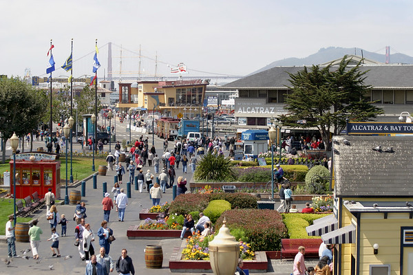 A horizontal stock photograph of people walking at Pier 39 San Francisco California.