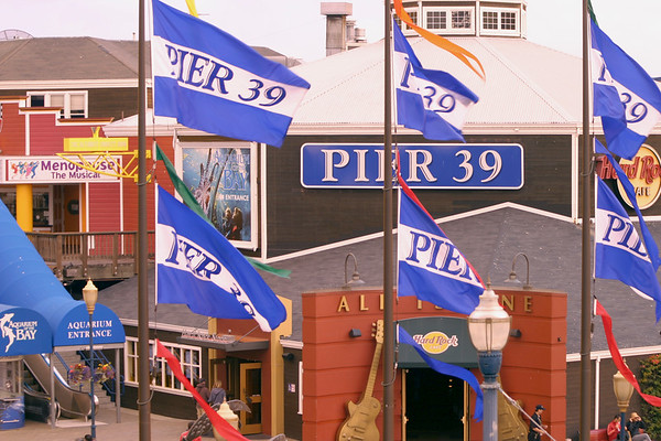 A horizontal stock photograph of the flags at Pier 39 San Francisco California.