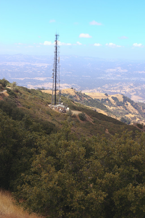 A vertical stock photograph of a scenic view from Mt.Diablo showing radio tower in foreground.