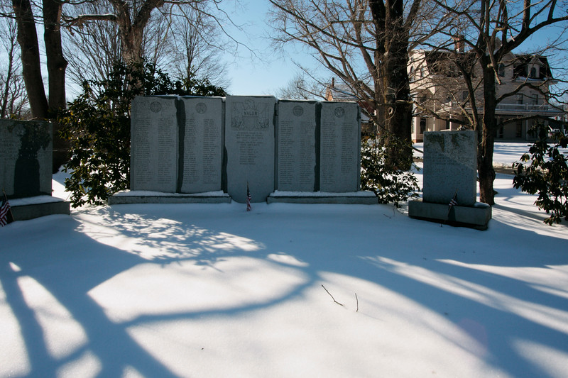 A horizontal stock photo of the war memorial in Brooklyn Connecticut on a bright sunny winter day.