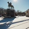 A horizontal stock photo of the statue honoring Isreal Putnam Esq. A Senior Major General in the Armies of the United States of America located in Brooklyn Connecticut. Photo taken on a bright sunny winter day.