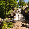 People enjoying Chapman falls in Devils Hopyard State park, Connecticut. Abeautiful summer day at a beautiful waterfalls.