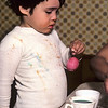 Very young boy coloring easter eggs