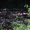 Young boy tubing down the Farmington River Ct.