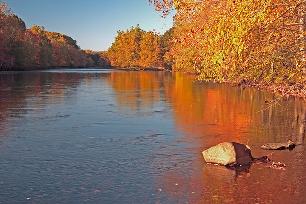 A horizontal Stock Photograph of the Shetucket River Scotland Ct. on a beautiful Fall afternoon.