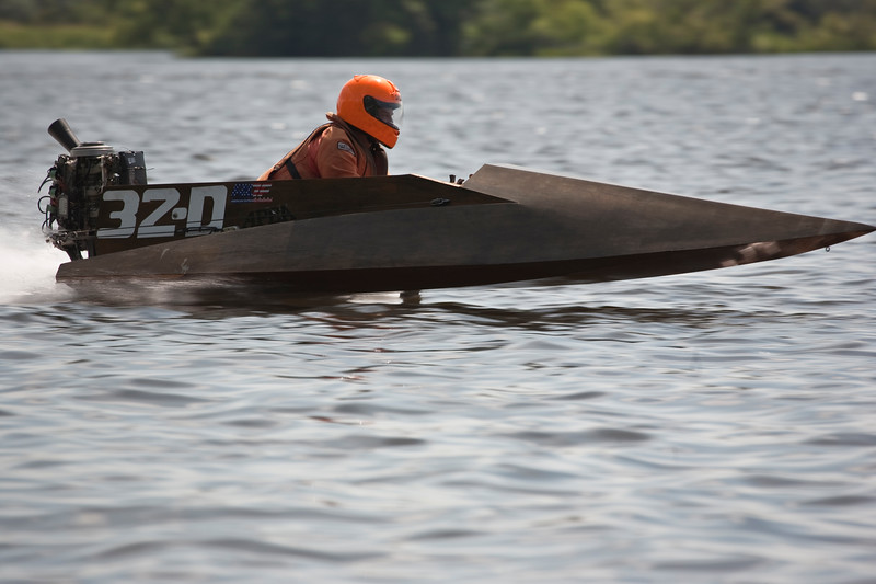 A close-up view of a boat speeding by in an APBA racing event at Thompson lake Connecticut