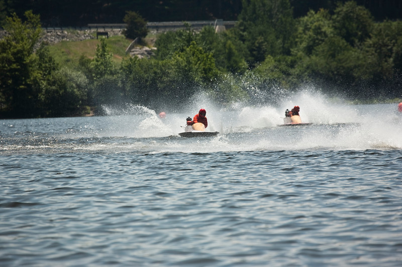 Boats competing in a apba event at thompson lake ct.  Water is spraying behind the high speed boats.