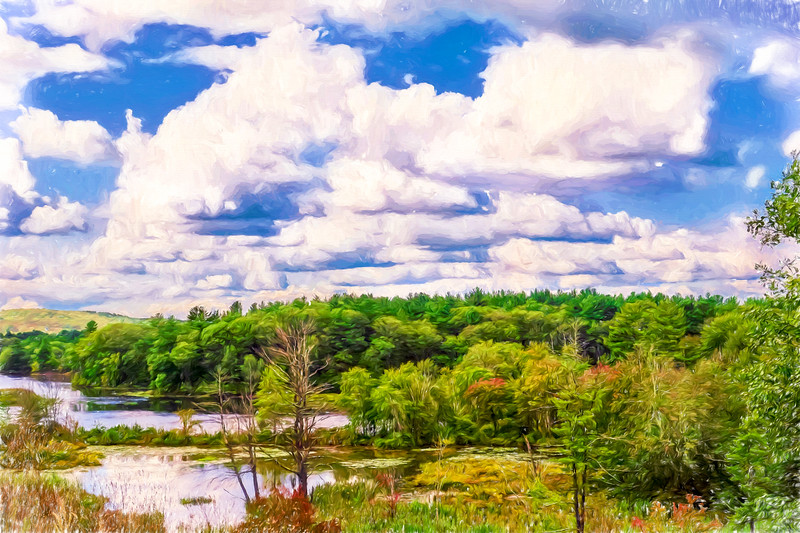 Striking clouds above small water inlet and green trees