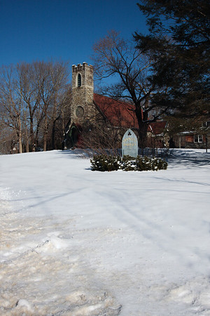 A vertical stock photo of the Trinity Parish Church in Putnam Connecticut.A beautiful historic Church. Photo taken on a  bright sunny Winter day.