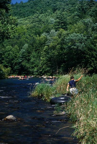 Young boy tubing the Farminton River Ct.