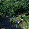 Young boy tubing the Farminton River Ct.