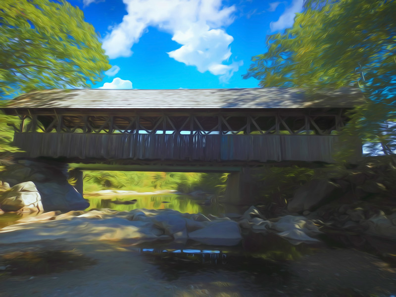 An old covered bridge in Western Maine. Time is leaving this old bridge behind,but still has grace and beauty.