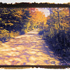 A back road through the autumn foliage.